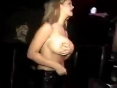 Blonde flashes huge boobs at wet t-shirt contest