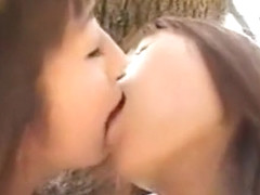 Schoolgirls In Uniform Kissing Passionately In The Forest