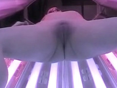 Lovely tart enjoys fingering her fanny in a solarium