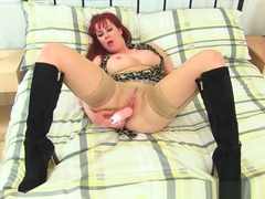 English milf Tanya Cox stuffs her knickers up her fanny