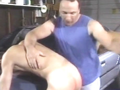 Daddy spanks the boys in the garage