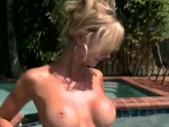Cute and sexy blonde Natalie Nice showing her body on a pool