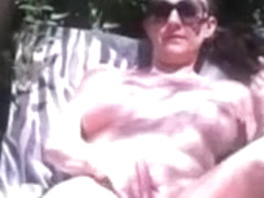 Chick Tanning And Rubbing Pussy