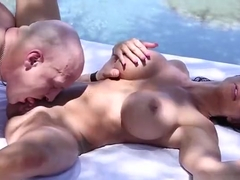 Sexy buxomy MILF Jewels Jade gets her ass drilled very hard outside