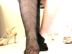 Thick legs put on tights with a pattern and high-heeled shoes. Foot Fetish.