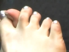 Japanese girl's small silver toes