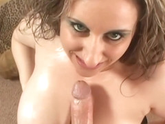 Big titted housewife, Kitty Lee is rubbing a rock hard dick and eating fresh cum