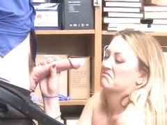 Blonde thief on knees sucking guards dick