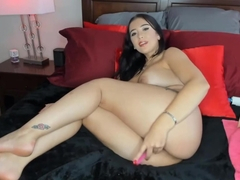 Beautiful tattooed brunette plays anal beads