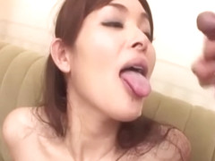 Hitomi Kanou gives top blowjob on two large cocks