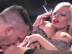 To spice up a blowjob, smoking hot blonde is also smoking a cigarette, along the way