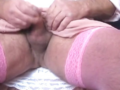 My pink pleated skirt and stockings wanking