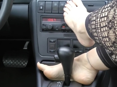 Gorgeous feet in the car