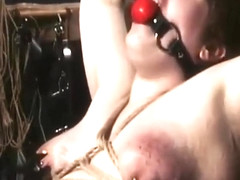 GAGGED BRUNETTE WITH PIERCED NIPPLES GETS TREATED IN HARDCORE MODE