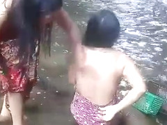 Beautiful girls having bath outdoor