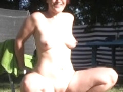 German redhead fucks a bottle of champagne outdoors