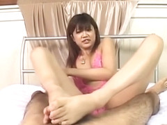 Rika Hayama in pink lingerie strokes penis