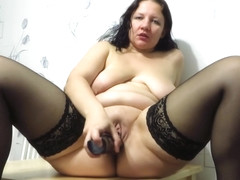 mature lady with big tits fucks a bottle!