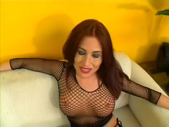Slutty redhead in a sexy fishnet outfit Ginger Lea loves to get fucked in the ass
