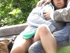 Curvy Asian caught making out in a kinky Japanese sex video