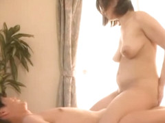 Big boobed Japanese AV Model is a hot milf with a hairy pussy