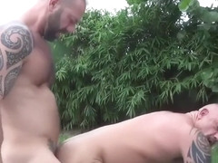 Strong muscular bear sex by the garden pool