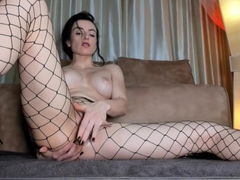 Leather Shorts Fishnets and a Glass Dildo