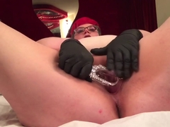 Tattooed and pierced NB BBW playing with gloves, speculum, and dildo