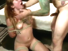 Racy Claire Robbins acting in BDSM video