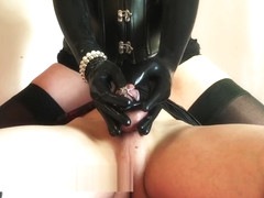 Amateur Dominatrix in leather teases chastity slave in cage