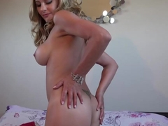 Sensual blonde lady is about to treat us with a strip- tease and some pussy drilling