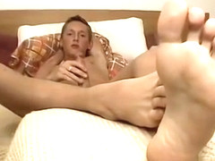 Blond twink Veso shows off his feet while beating his meat