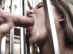 Lana Violet is wearing white, fishnet outfit while sucking her masters dick from the cage