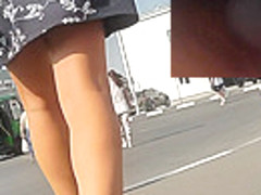 Upskirting cute slim girl in the wonderful sunny day