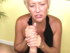 Busty mature tugging dick and gets cumontits
