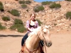 Ridiculously busty Sierra Skye rides the horse