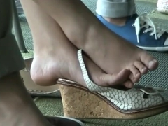 Asian Shoeplay in library