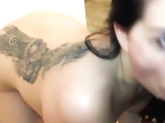 Little Brunette Is On Her Knees Giving Head To A Big Cock T
