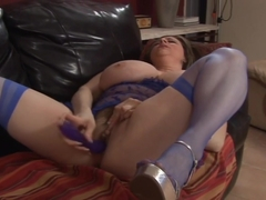 Busty Kitty Lee Plays With Herself In Stockings On A Couch