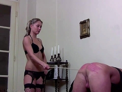 Two mistresses take turns in hard caning their slave
