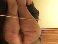Hard caning of bound woman