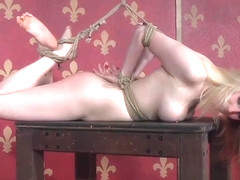 Nipple clamped blonde tied down and toyed