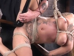 Hogtied suspended slave gets toyed
