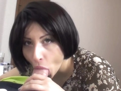 Brunette MILF with short hair Giving a BJ