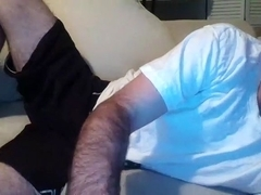 Naughty fagot is jerking off in the guest room and shooting himself on web cam
