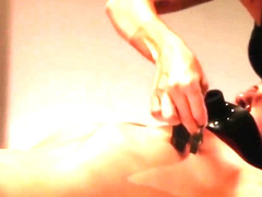 Lezdom bdsm dominant uses clamps