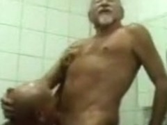 Mature gay men fuck in a public toilet