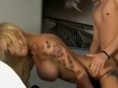 Hot slim blonde with fake tits and tattoos goes down on lucky guy