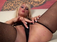Blonde Faye using a whip as a dildo