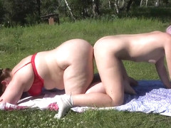Lesbians shake big booty outdoors and fuck doggystyle with double-sided dildo.